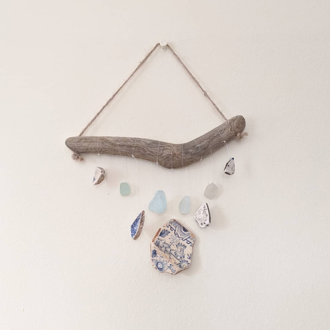 Sea Glass ,Sea Pottery and Driftwood Mobile🌊🌸 I love these pieces of pottery😍, they were definitely too good to paint over, so I decided to showcase them in a mobile with some beautiful pale blue and white sea glass. . . . #handmade #mobile #seaglass #seapottery #sea #ocean #driftwood #beachcombing #cornwall #beach #beachart #rustic #walldecor #etsyuk #etsy #estyshop