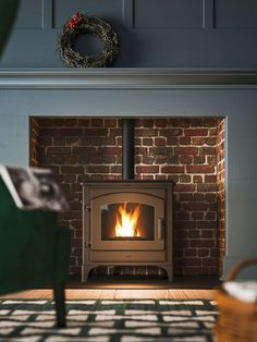 Eco Friendly Range Of Pellet Stoves For The Modern Home Freestanding Fireplace Pellet Stove Wood Stove Surround