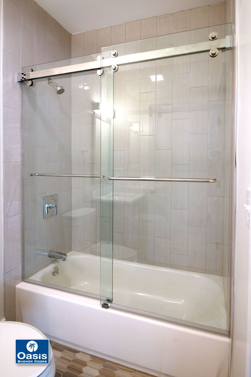 The Oasis Accella Sliding Shower Door Features 3 8 Thick Safety Glass Panels Hung From An Ind Sliding Shower Door Shower Doors Frameless Sliding Shower Doors