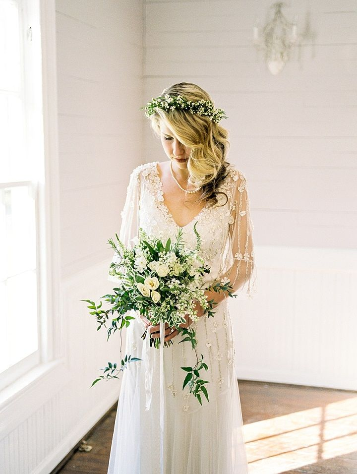 A floral gown and her upswept hair + white and green wedding bouquet | itakeyou.co.uk #wedding #weddingdress #wedingbouquet #weddinginspiration #weddinghairstyle #bride