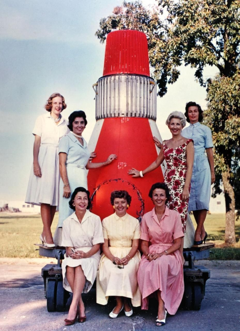 In 1959, the wives of the Project Mercury astronauts pose ...