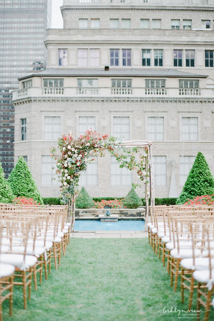 Stunning Fall Inspired Floral Arch For Rooftop Wedding Ceremony At