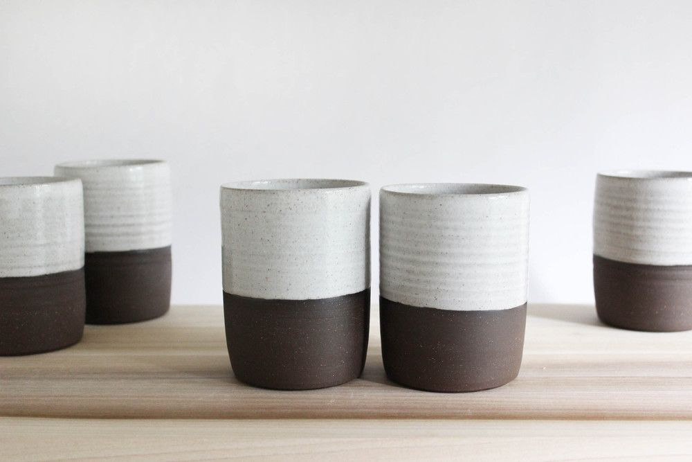 Julia Paul : 50/50 cups www.juliapaulpottery.com  Creamy white speckled glaze on chocolate brown stoneware. No handle needed. Good for tea, coffee, beer. May remind you of the forest.  height: 4 in.  rim diameter: 3 in.