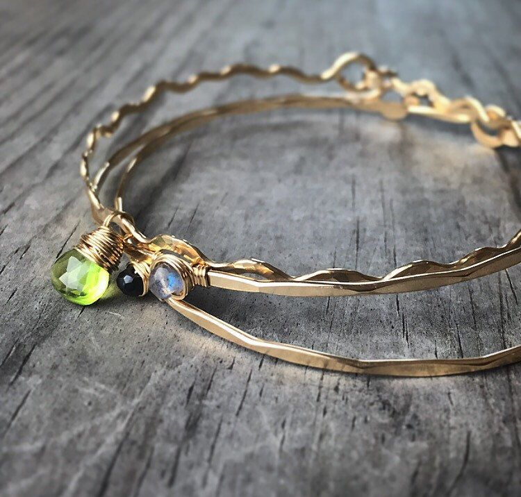 A personal favorite from my Etsy shop https://www.etsy.com/listing/211814286/three-gold-gemstone-bangles-14k-gold