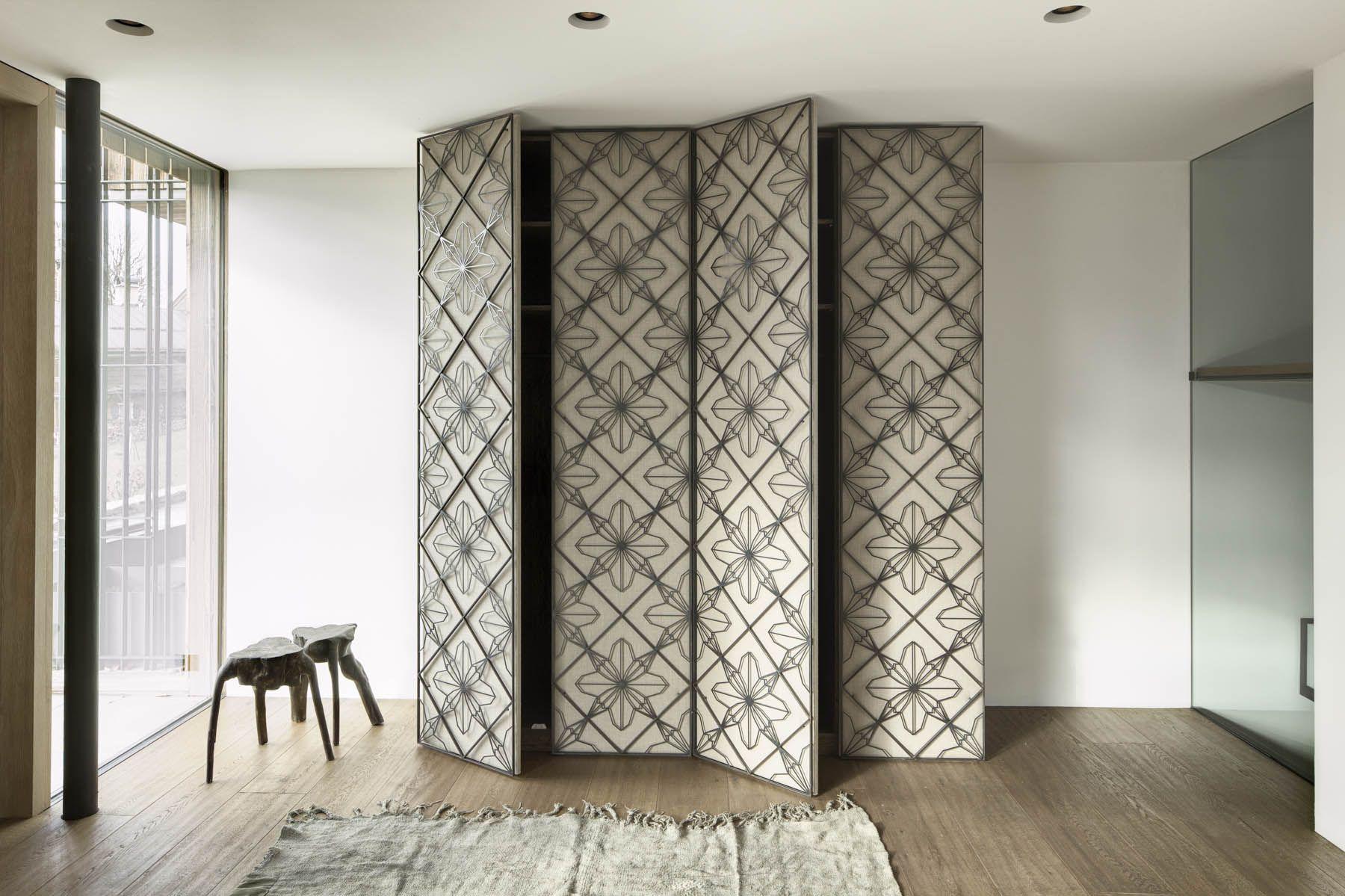 armoire with metal screen door