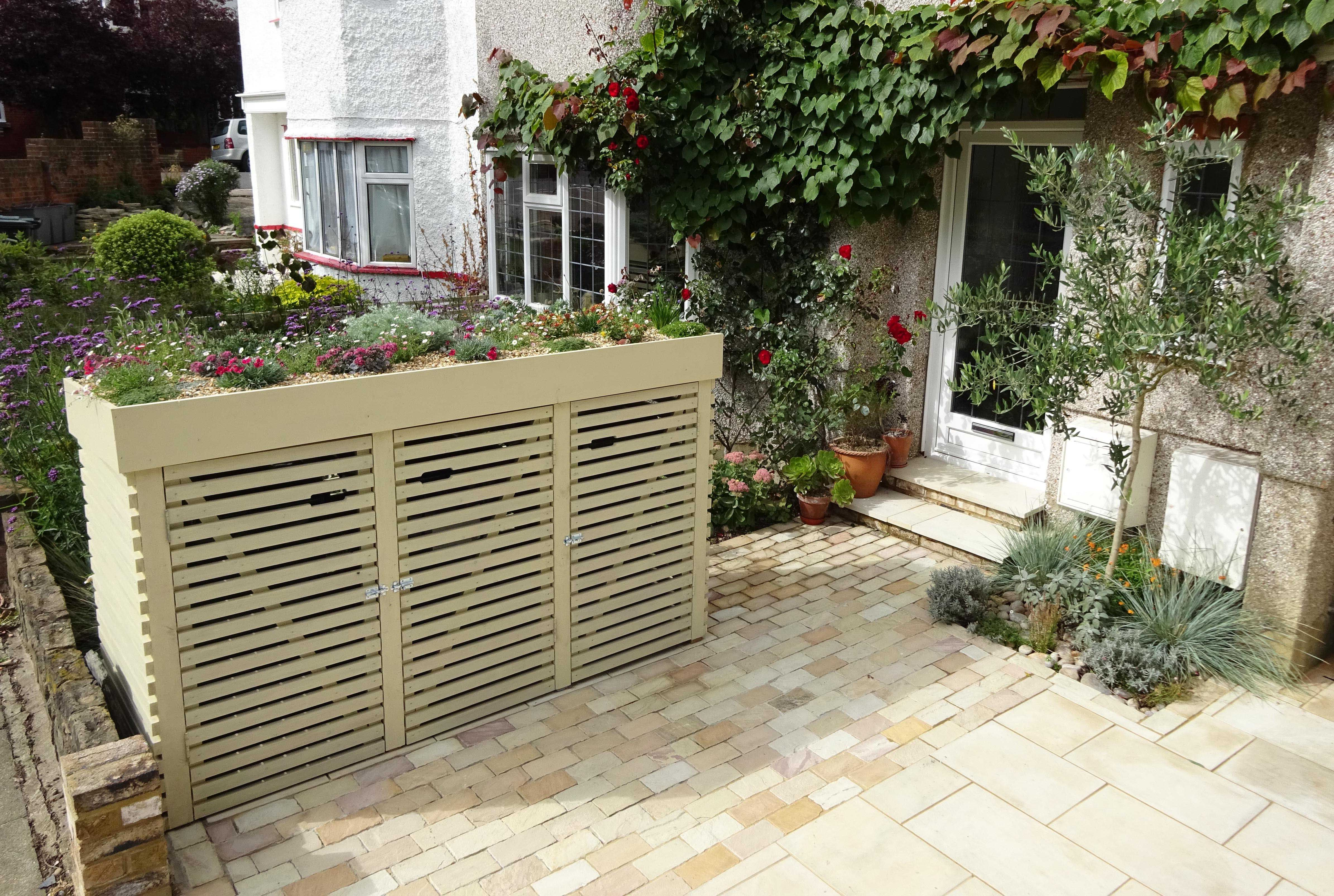smart garden storage to hide the bins for a utility area the