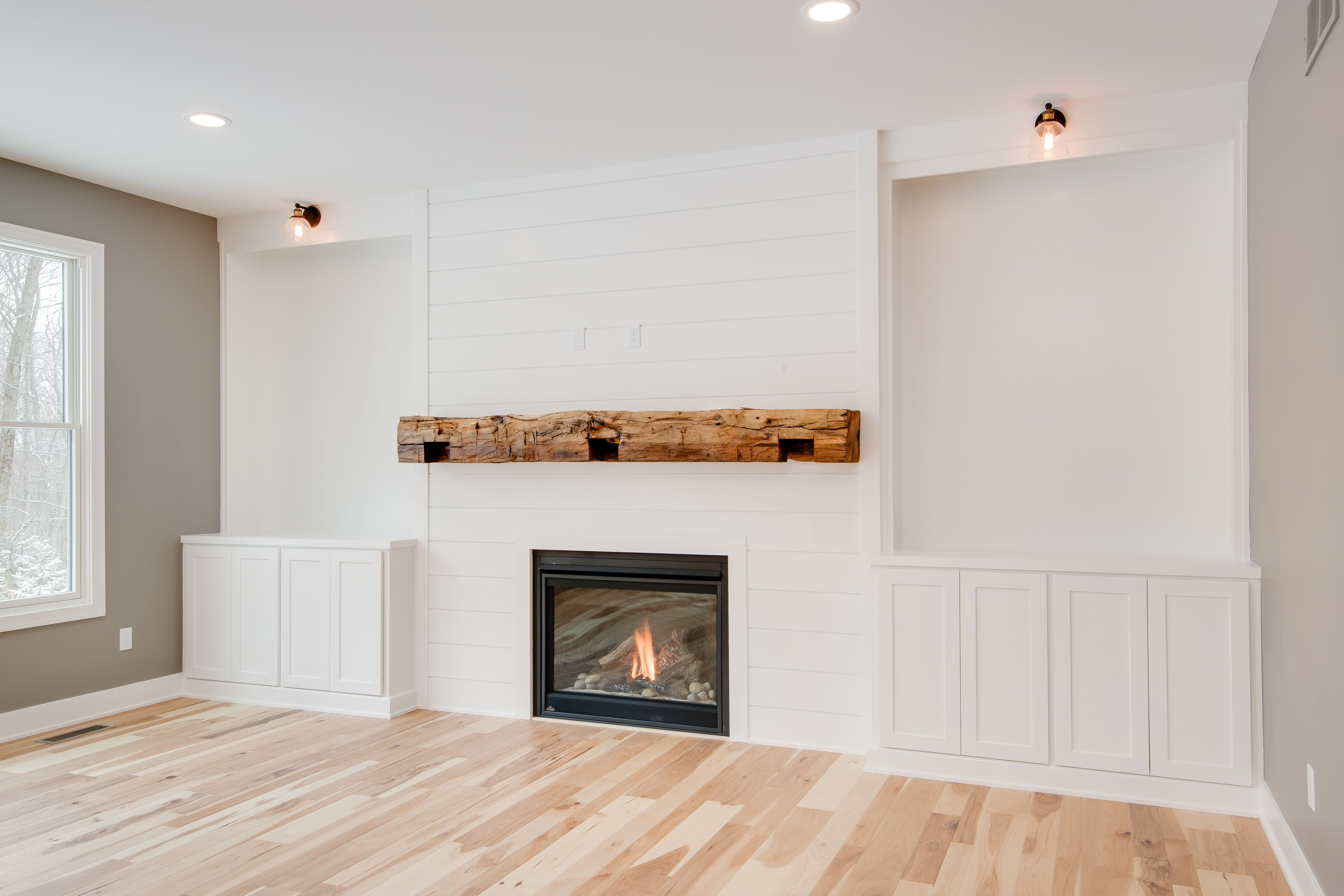 Living Room Natural Hickory Wood Floors Painted Shiplap Fireplace Surround Gas Fireplace Floati Fireplace Built Ins Wood Fireplace Surrounds Home Fireplace