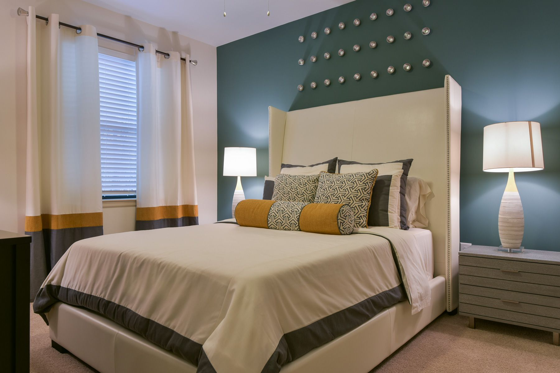 Encore clairmont in georgia bedroom with dusty blue accent wall