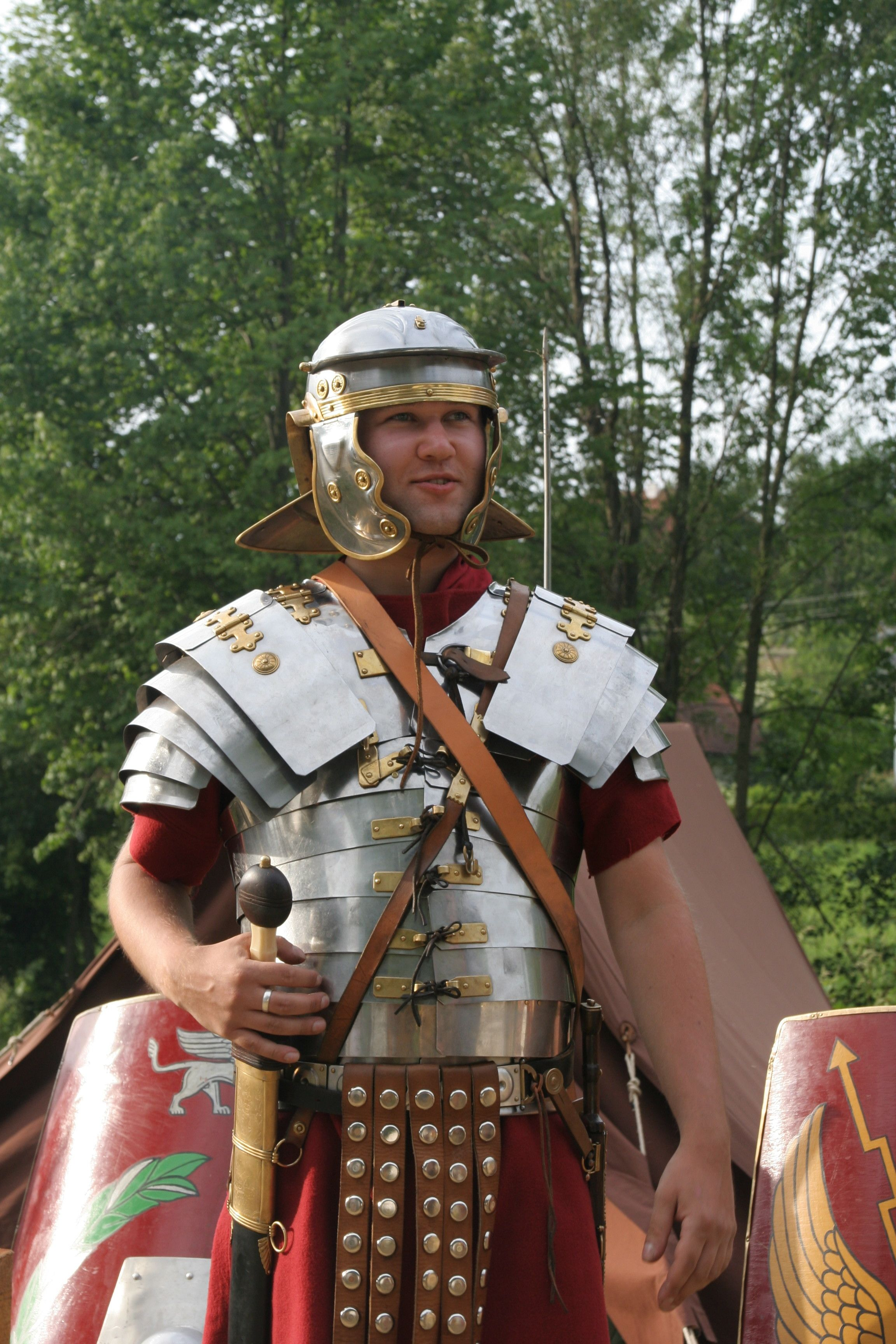 Armour - a re-enactor as a Roman legionary the gladius and pugio on each hip with lorica segmentata armour on the chest