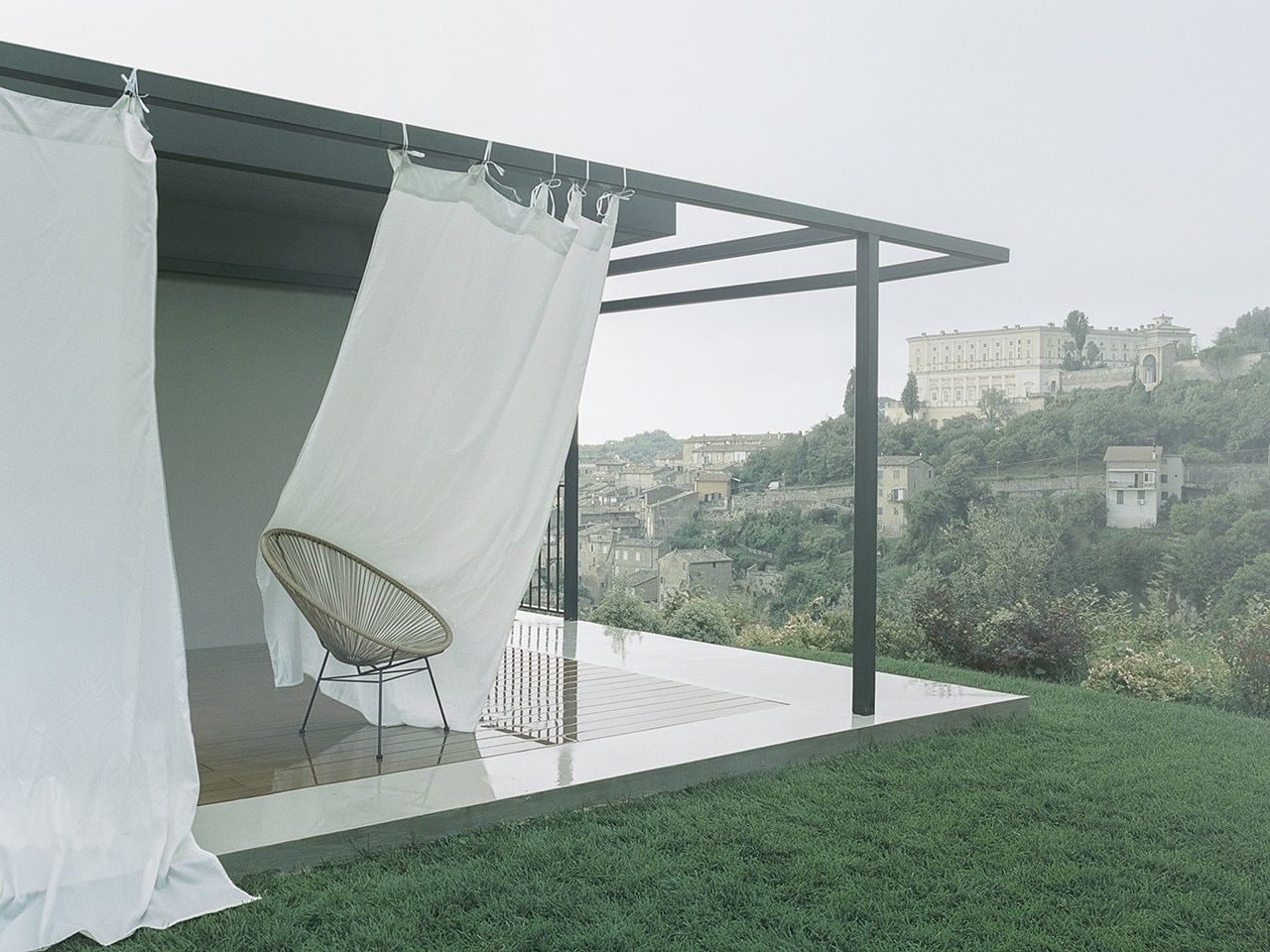 Metal frame wraps a house in the Lazio countryside
