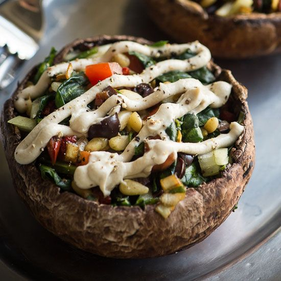 These delicious stuffed mushrooms are topped with a decadent vegan rosemary cream. What a great appetizer or main dish for family or guests.
