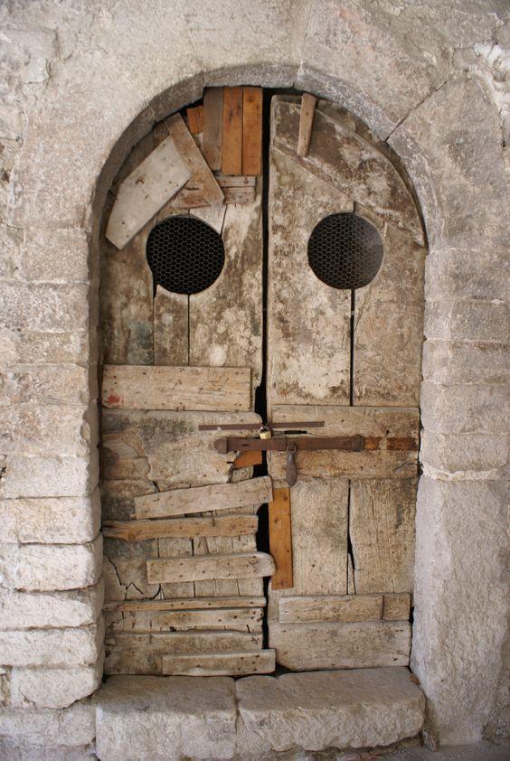 Door in Italy. It reminds me of an owl.: