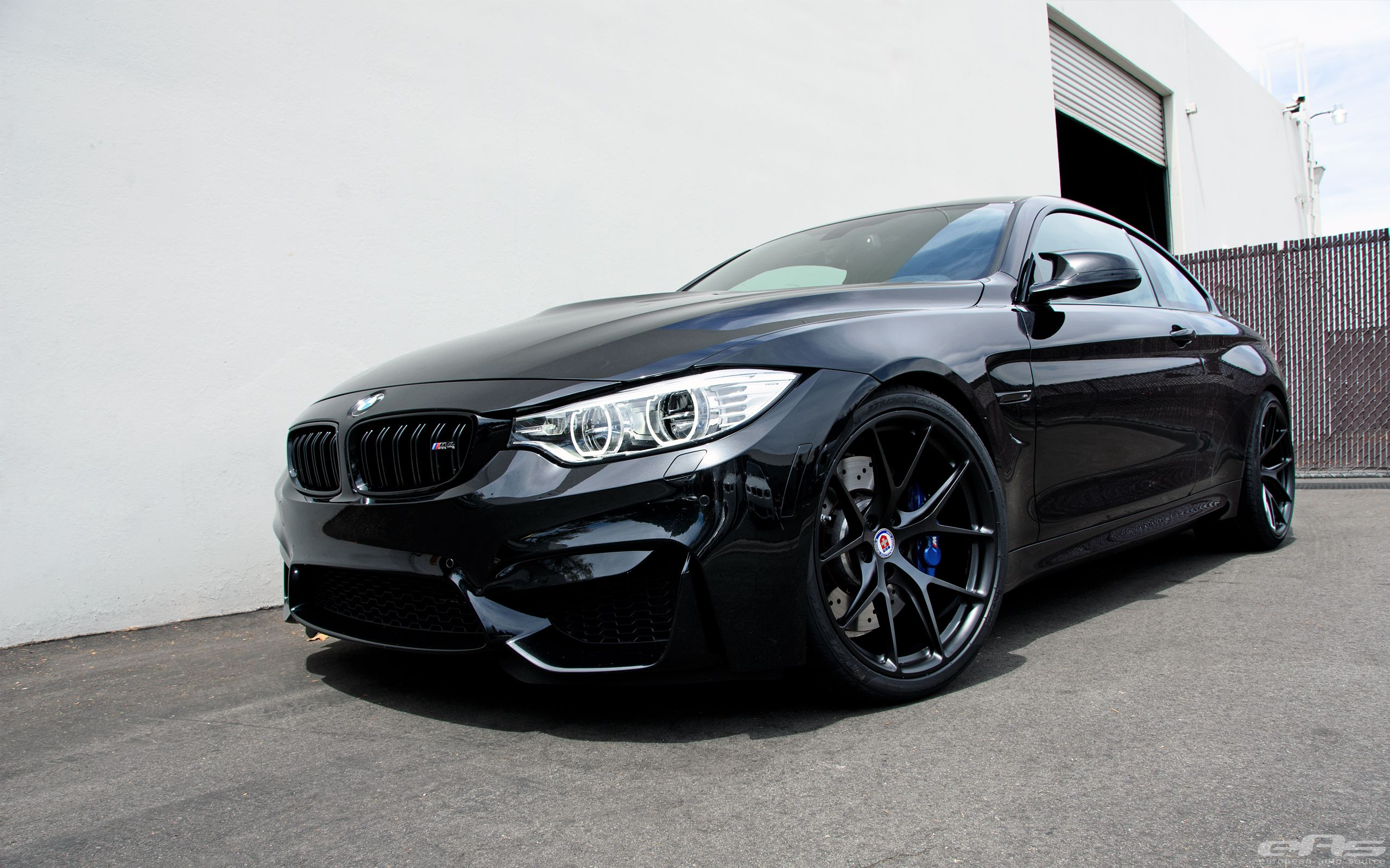 A Black Sapphire BMW M4 with a set of HRE P101 wheels in Matte Black