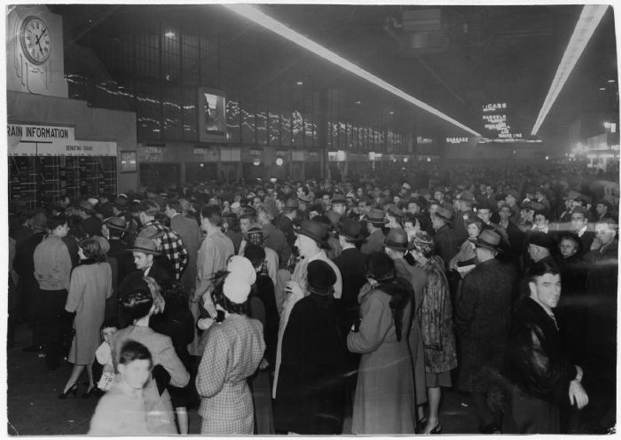 People check the board for arrivals and departures during the Christmas on Dec. 1, 1946. Within a few decades, the crowds had moved to Lambert-St. Louis International Airport.  Post Dispatch files
