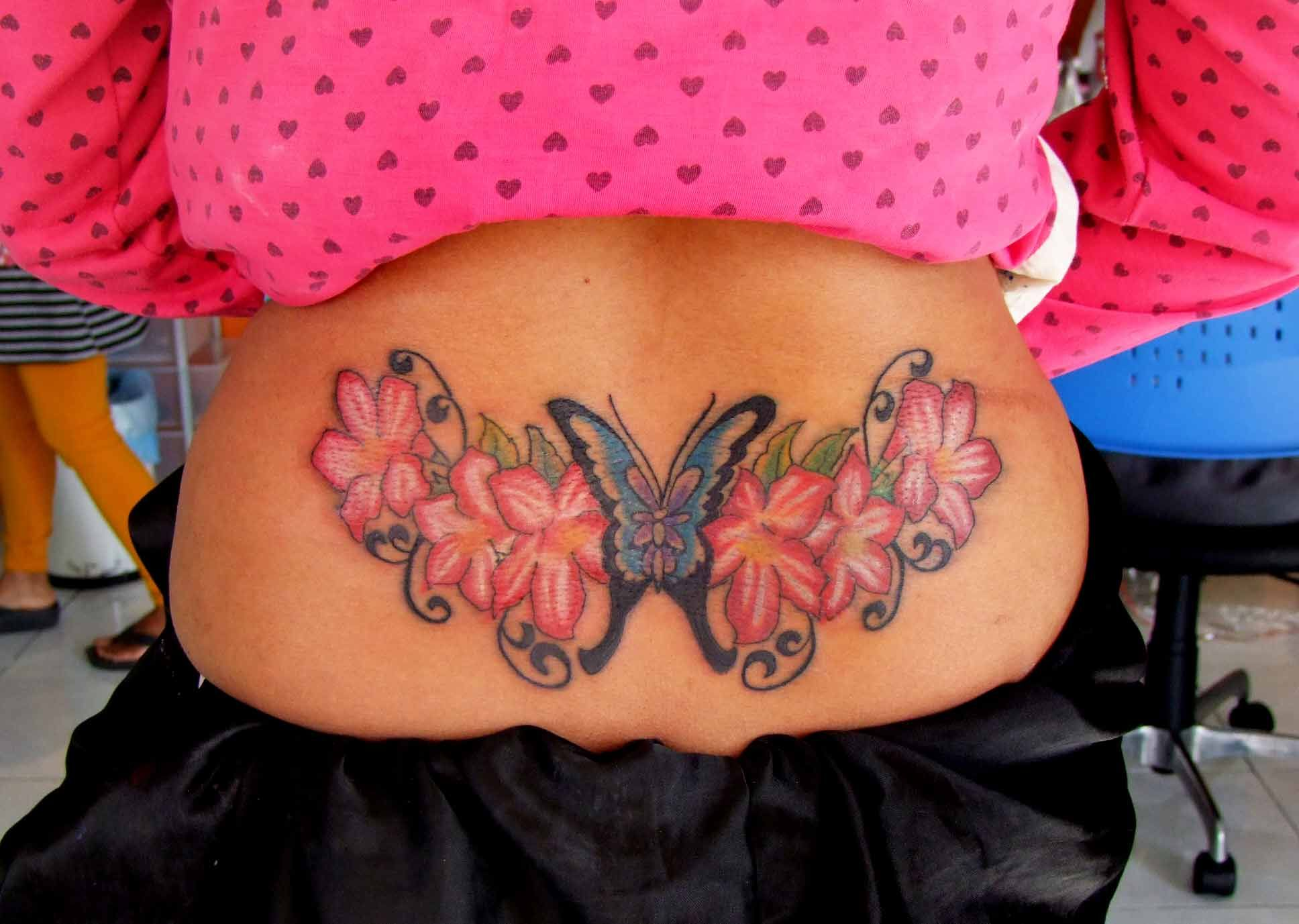 Cute tattoo ideas for lower back lower back butterfly tattoo with flowers  lower back tattooes
