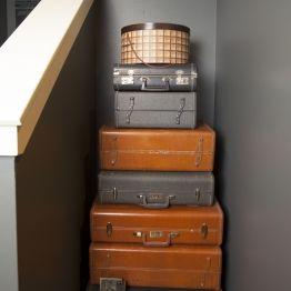 Kristina Wilson Design Houston Center Street Gray Walls Stacked Suit Cases