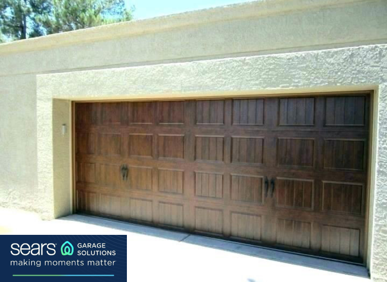 Do You Love The Look Of A Wooden Garage Door But Don T Want To Pay Wood Door Prices Well Then This Is Wood Garage Doors Fiberglass Garage Doors Garage Doors