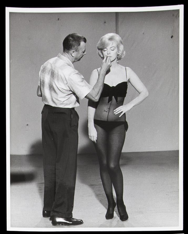 """Marilyn Monroe & Allan """"Whitey"""" Snyder. He was her long-time makeup artist and close friend. She asked Whitey to promise her that he'd do her makeup for her funeral she died 1st. He replied, """"Sure, drop off the body while it's still warm and I'll do it."""" Amused, Marilyn bought him a gold Tiffany money clip engraved: """"Whitey Dear: While I'm still warm, Marilyn."""" When she died, Joe DiMaggio reminded Whitey of his promise. Whitey did her makeup one last time and was one of the pallbearers."""