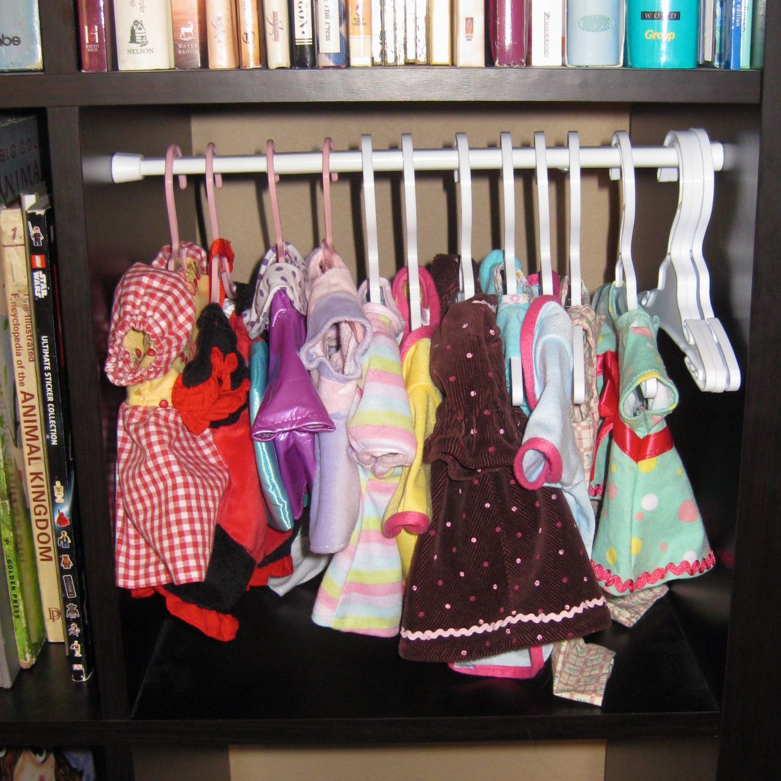 Closet For Doll Clothes In A Small Bookshelf Cubby Using A Tension Rod This Is An Expedit Bookshelf Short Tens Small Baby Nursery Small Bookshelf Diy Doll
