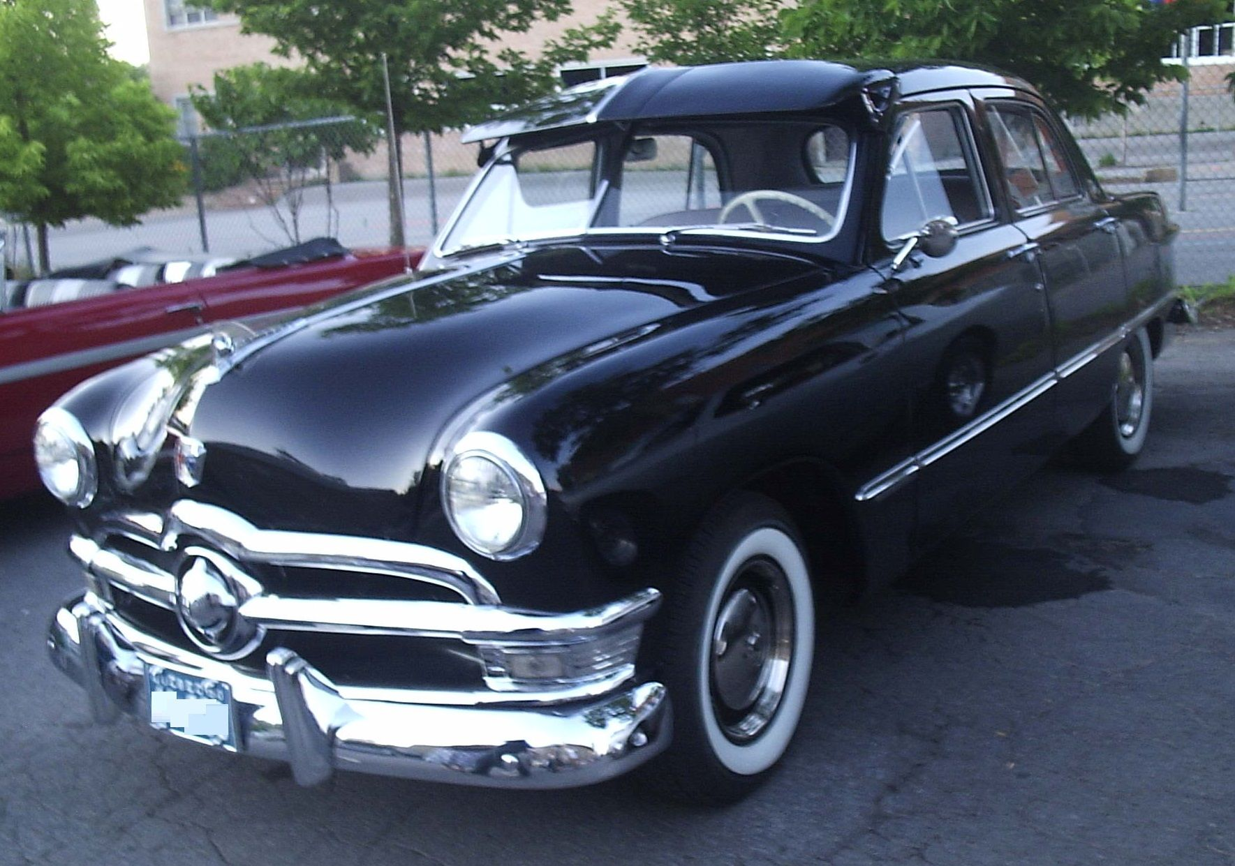 1950 ford custom sedan my first car was similar except it had a cream colored top with a polynesian bronze color below the windows added fende