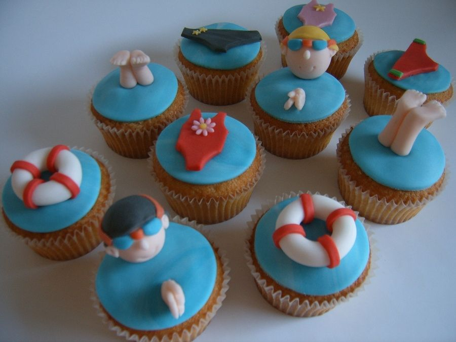 We love these swimming-pool-themed cupcakes - We suggest removing the flower from the bathing suit and adding a lifeguard cross!
