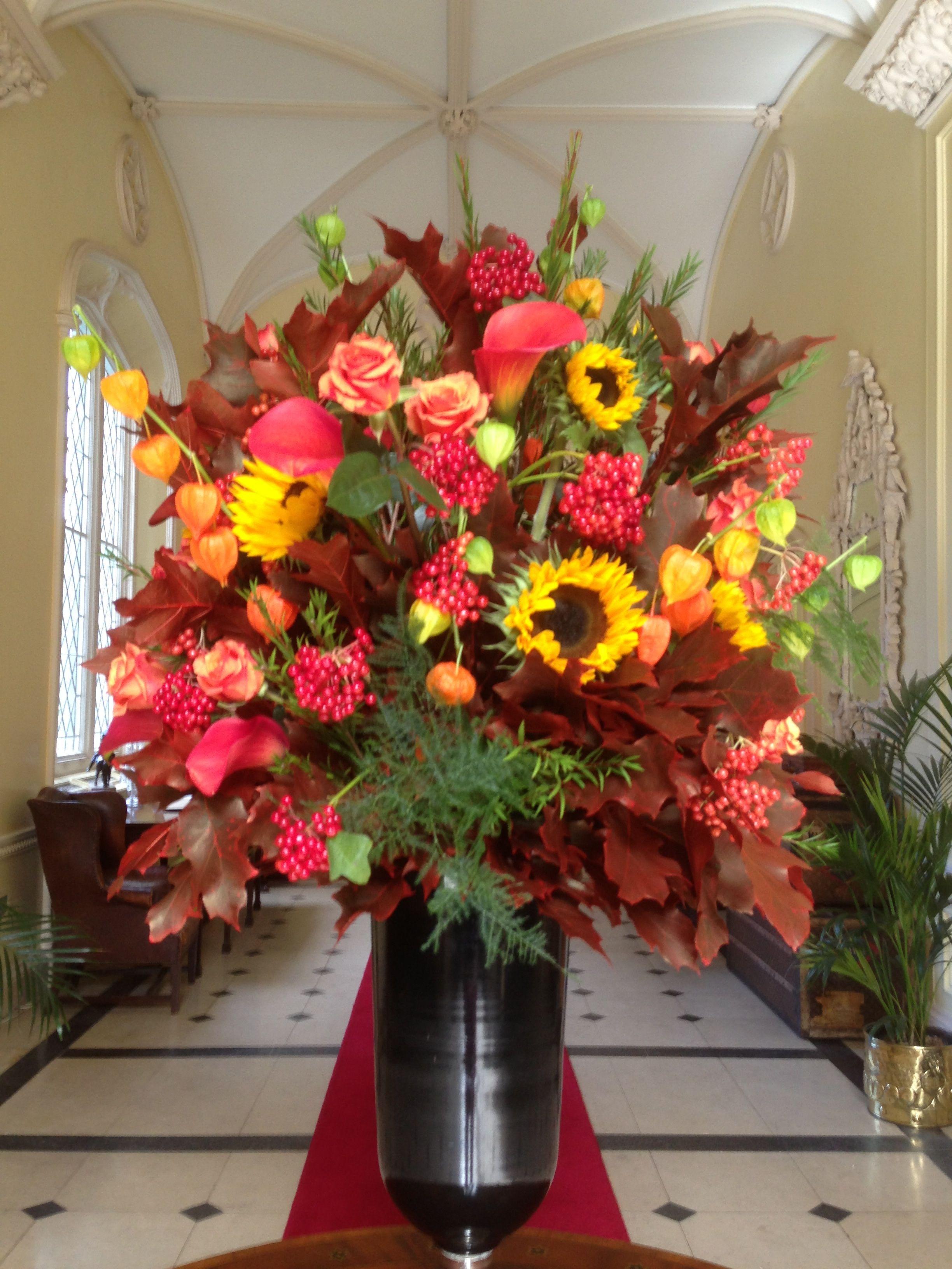Large autumn arrangement of oak leaves, Sunflowers, Ilex ...