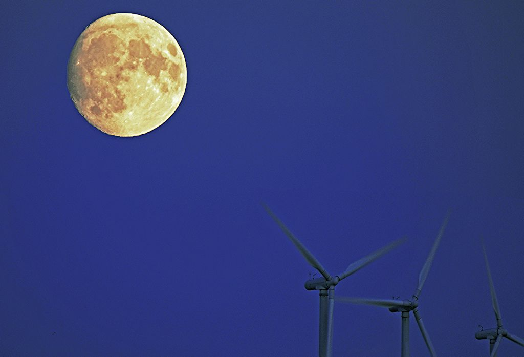 Wind turbines and Supermoon over the Baltic sea. by MRCPH