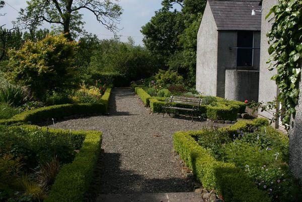 Ballyrobert Cottage Garden County Antrim Northern Ireland Formal Gardens Are Laid Out In The Shape Of A Celtic Formal Gardens Country Gardening Irish Garden