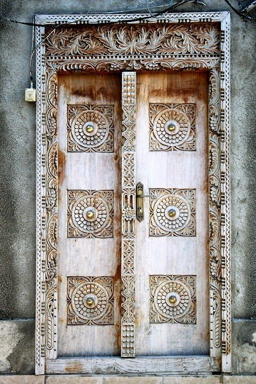 Stone Town Zanzibar has a lot of beautiful history u0026 Eastern architecture like this stunning wooden Arabic door with an intricate frame u0026 brass knob. & Pin by nancy churchill on Doors | Pinterest | Balinese Doors and ... pezcame.com