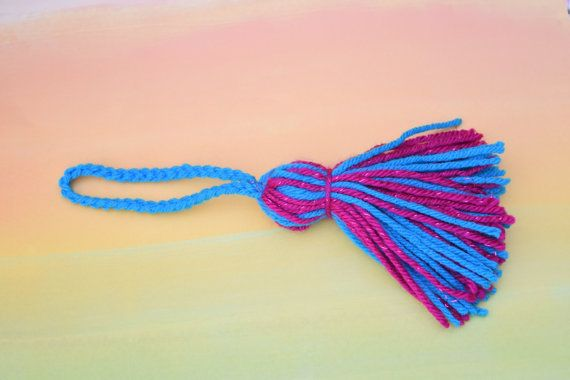 Tassel made of fall color yarn finished with a ribbon trim. You may purchase it alone or pair it up with 3 18inch washi samples