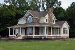 Love farm houses with wrap around porches!