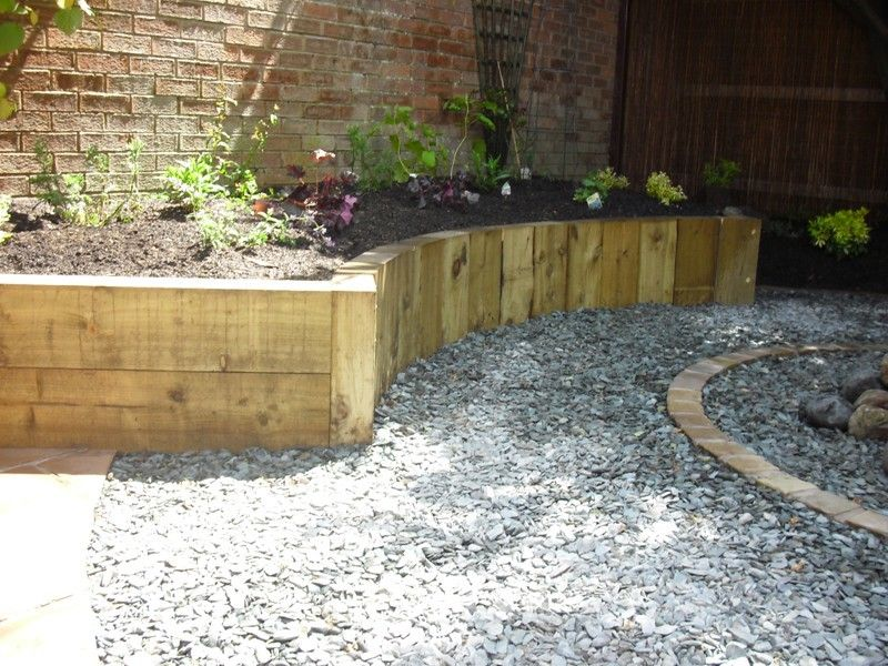 Landscaping Timber Garden Beds : Vertical oak sleeper retaining walls google search