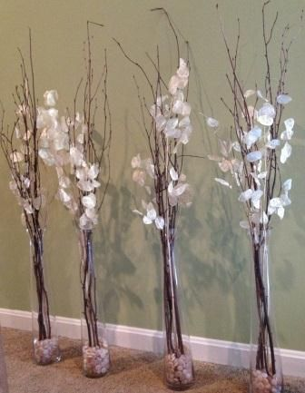 Willow Branch And Silver Dollar Branches In Tall Glass Vases With Small Stones Kissbride Glass Vase Decor Tall Vase Decor Floor Vase Decor