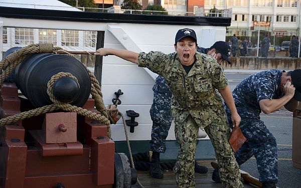 Lt jg Jessica Choi climbs a ladder onto the amphibious dock - surface warfare officer sample resume