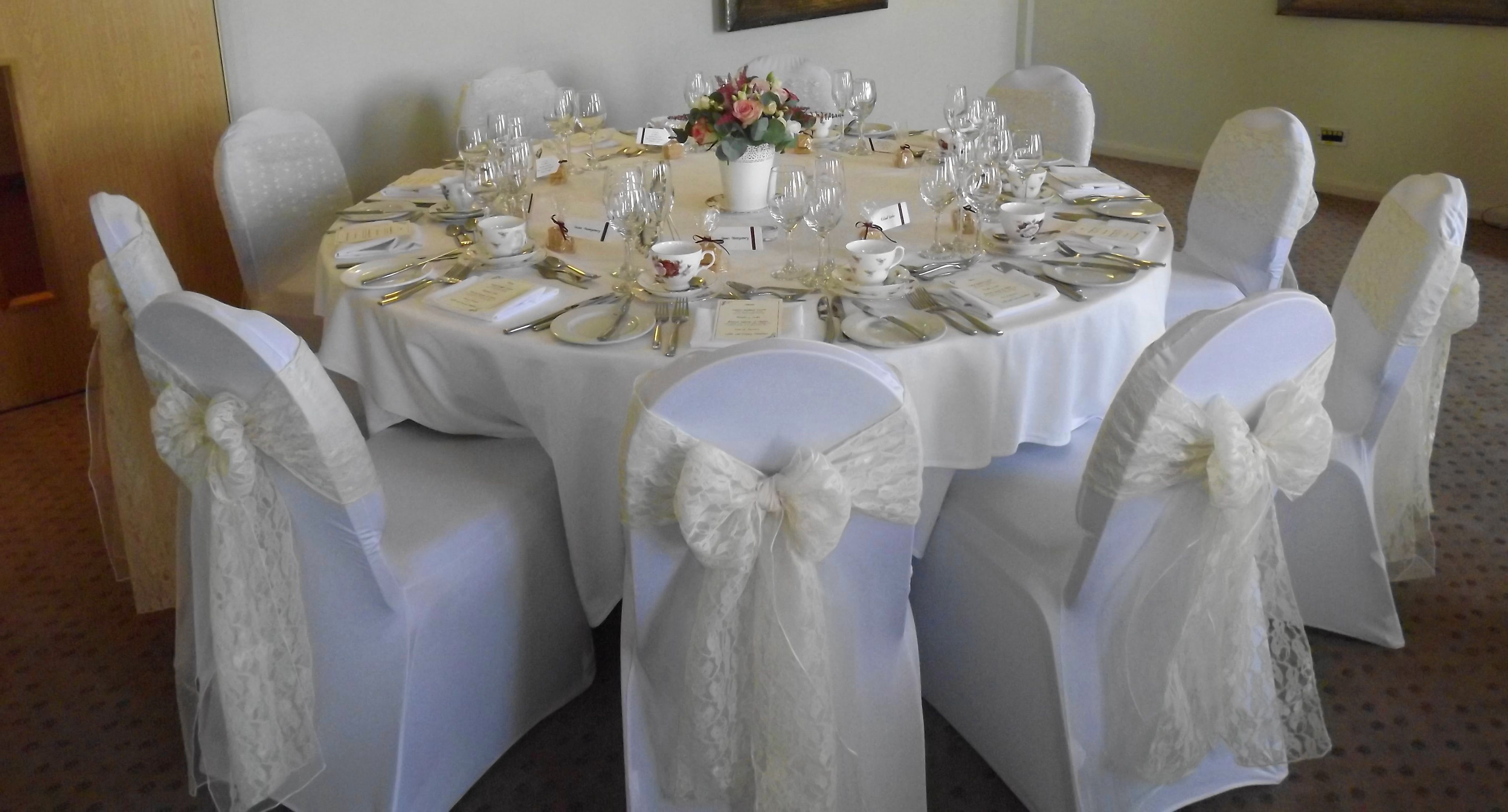 Ivory Lace Sashes Over White Chair Covers Wedding Chair