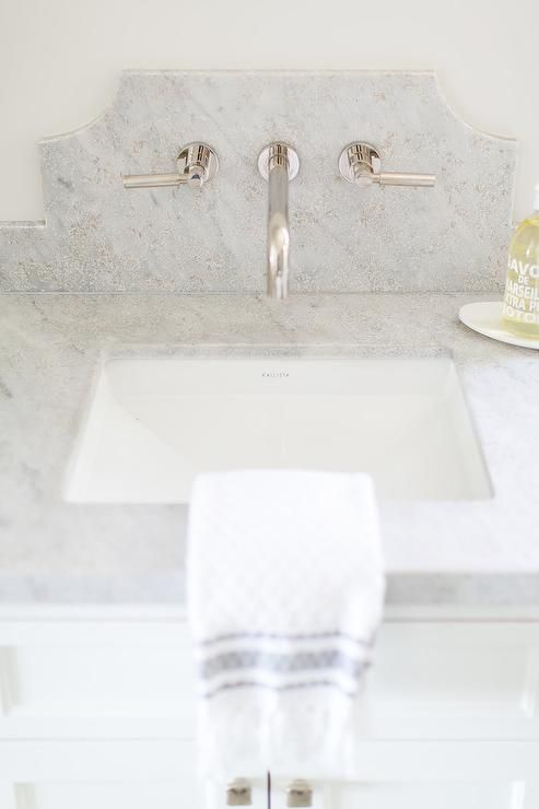 A Polished Nickel Faucet Is Mounted To A Curved Marble Backsplash Above A Kallista Sink Marble Backsplash Bathroom Wall Mount Faucet Bathroom Marble Backsplash