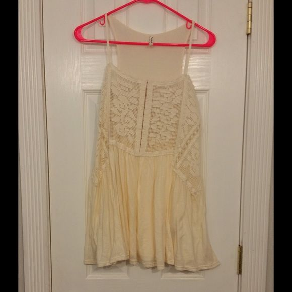 """🎉HP🎉Free People FP X Greenhouse Rose Tank This tank is NWT! Tag from boutique. It is an off white/ivory color. It is a tunic length. It has a beautifully embroidered chest and sides. It has hooks in the front vertically along the chest. The bottom is a free flowing skirt. The top back is a knit material. Approximately 16"""" across the bust when laid flat and 30"""" from shoulder to hem. Body: 100% polyester   Skirt: 100% cotton. Sold out. ❌PRICE IS FIRM❌ Free People Tops Tank Tops"""