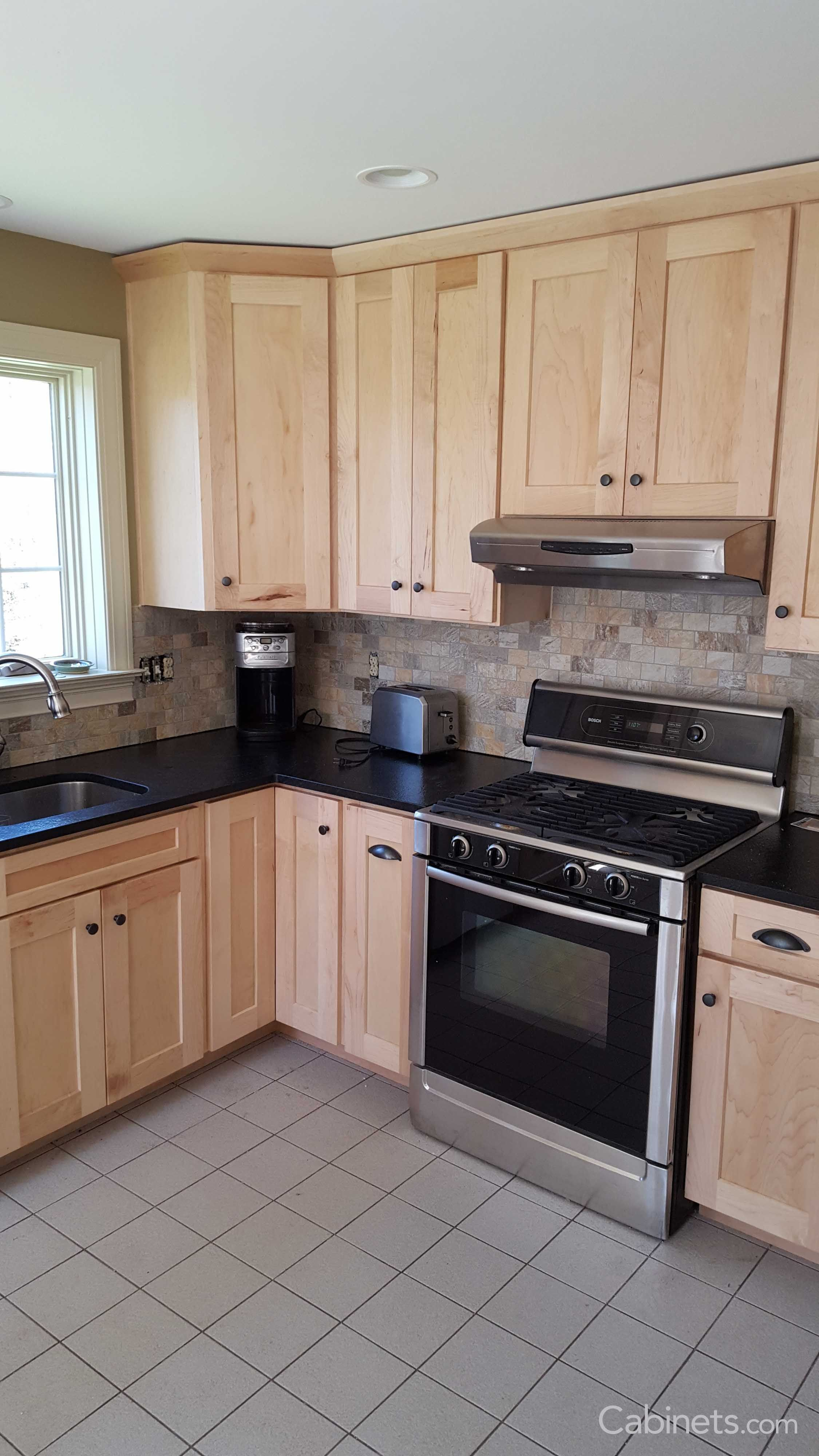 Small Shaker Kitchen with Natural Stained Cabinets and ... on Maple Kitchen Cabinets With Black Countertops  id=46264