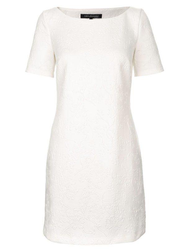 Sukienka damska Top Secret z kolekcji wiosna/ lato 2013. Kremowa, kobieca sukienka z krótkim rękawem i delikatnym zdobieniem. Fason lekko rozkloszowany.