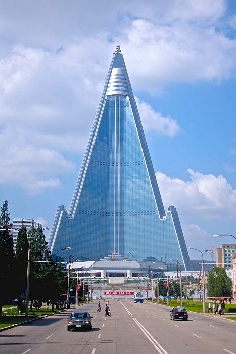 Ryugyong Hotel in Pyongyang, North Korea.  Construction began in 1987.  Still hasn't opened.