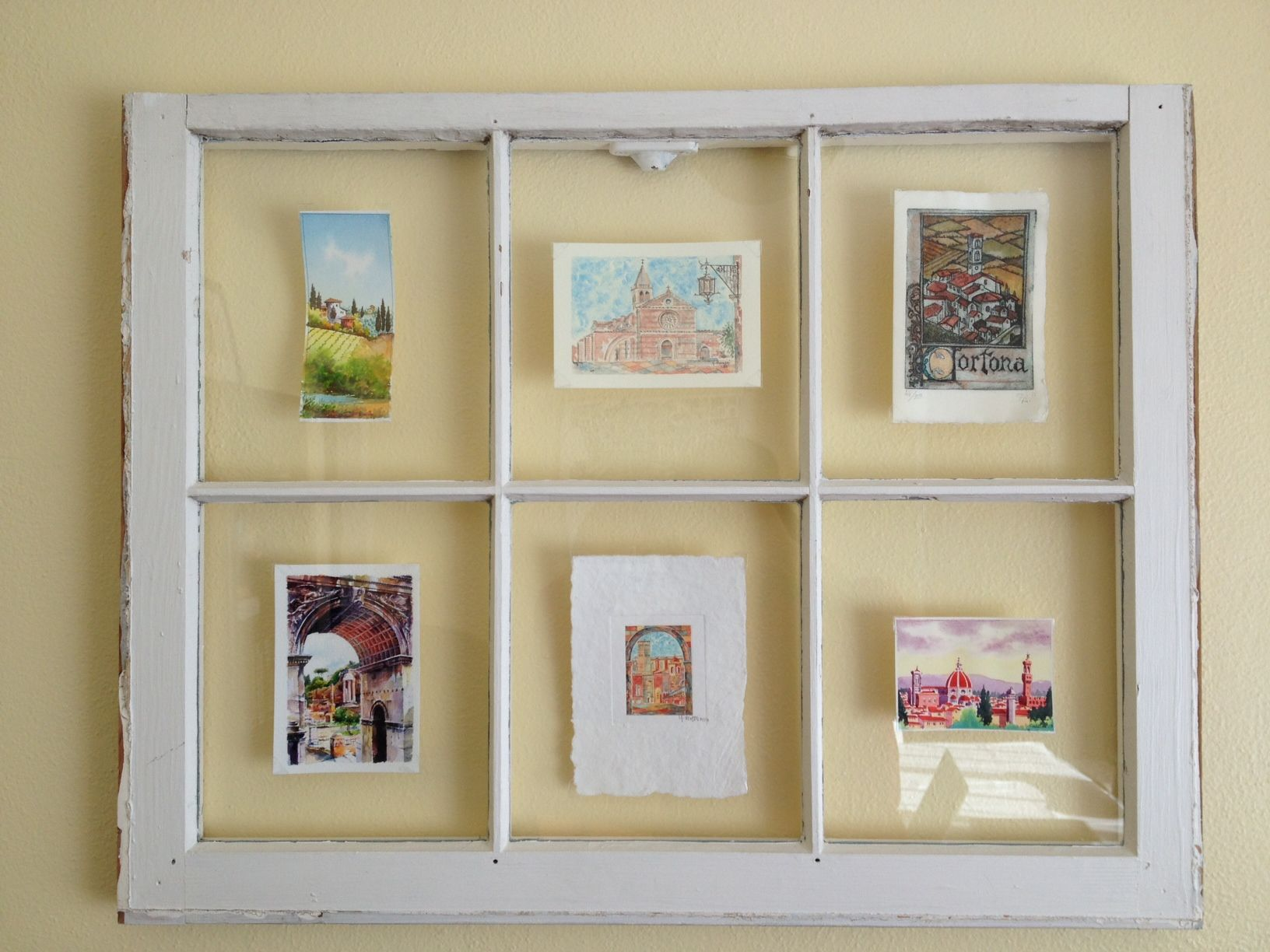 Old window with panes to frame a series of small prints. I used ...