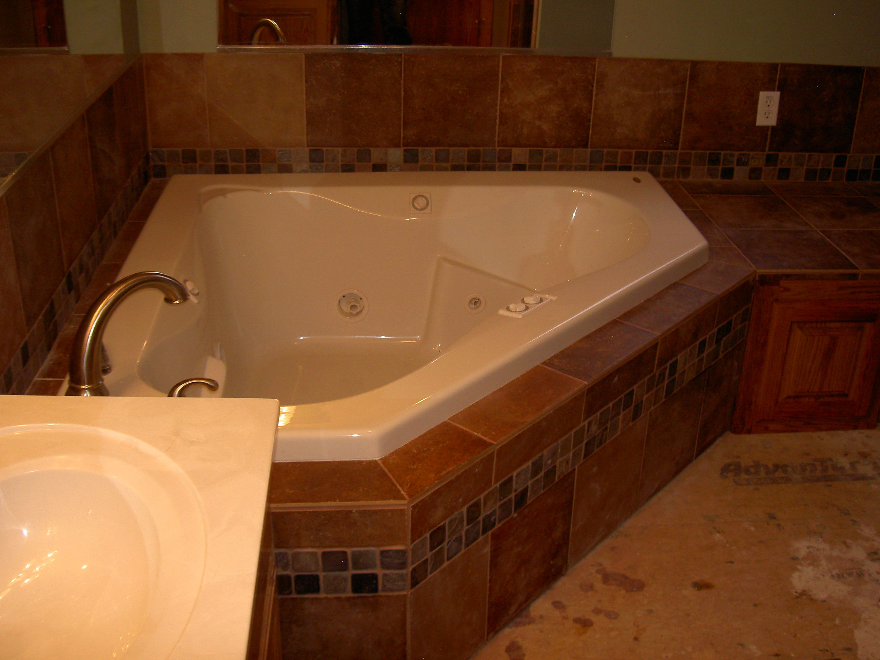 Jacuzzi corner tub tile surround. (picture before tile floor was ...