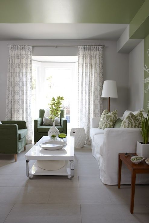 living rooms - Para Paints - Old Sterling - Para Paints Outside Influence Thibaut Ikat Fairfax Green pillows gray walls green ceiling white Ikea slipcover sofa green Ikea chairs glossy white lacquer coffee table