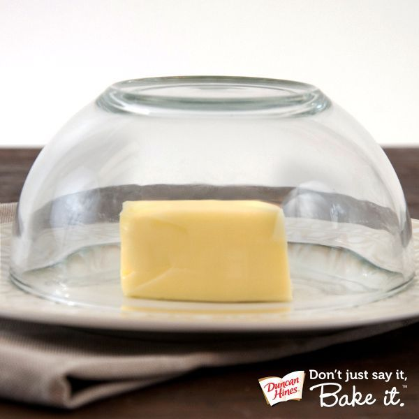 Microwave water in bowl or glass, dump water out, cover cold butter. Warm steam will rapidly bring butter to room temp