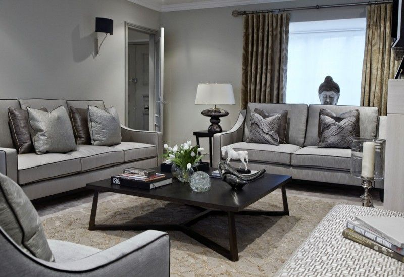 Grey Sofa Black Coffee Table Patterned Area Rug Window Cream Curtains Lamp Table Lamp Throw Living Room Grey Grey Furniture Living Room Grey Couch Living Room