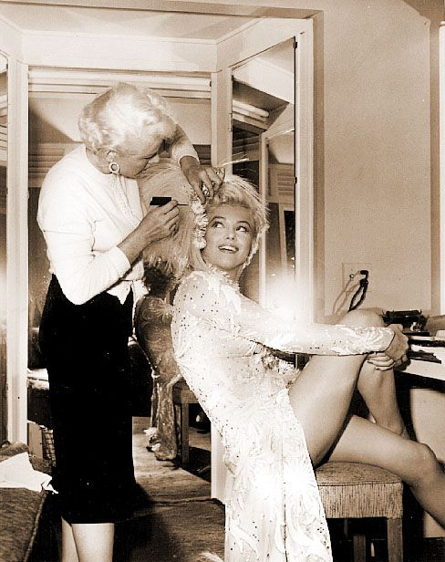 Here's what I see in this picture NOT {Marilyn Monroe in 'Gentleman Prefer Blondes' 1953} but the hairdresser. As someone who works in film and television this woman is more dressed up than I am when I go out...and she's at work for a minimum of 12 hours! I bet she's wearing heels too! Damn. Better woman than I, that's for sure. What a difference sixty years makes.