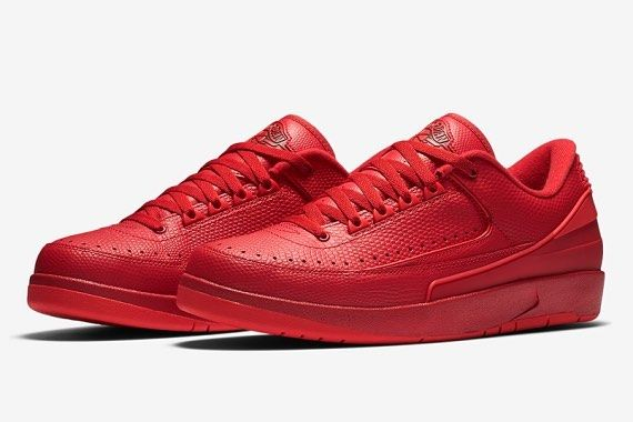 """Get the Jordan 2 Retro Low """"Gym Red"""": KickBackzNY.com  Essentially a low-cut rendition of the model the sneaker flaunts its defining hue across its entire profile. A reptile-like leather is utilized for the upper to further exude premium flair while tonal synthetics are applied on the rear which also solidifies its construction.  Notable contrasting elements are evidenced by the iconic wings logo on the tongue with black while the insoles are colored in turquoise. Finishing touches include…"""