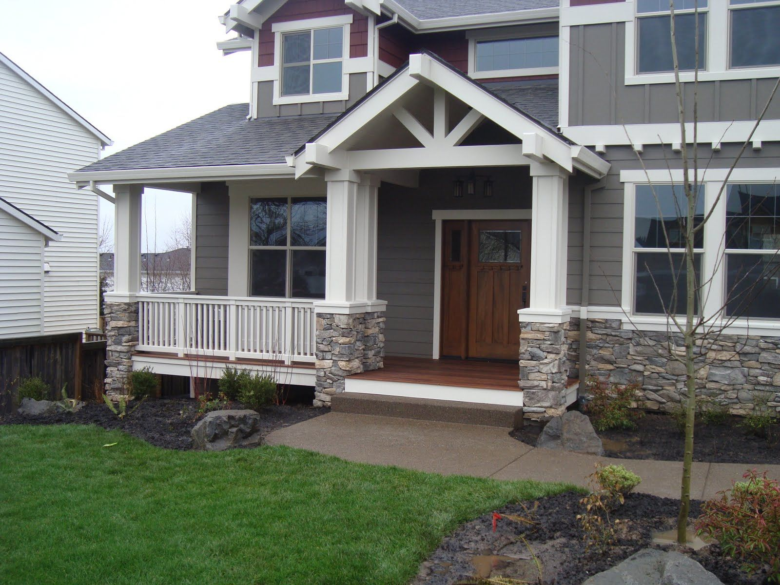 garage exterior rock vaneer siding | Halgren Construction