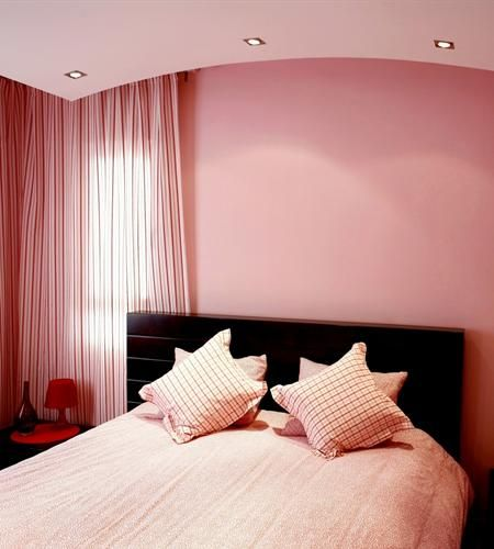 Pink bed room. don't over do it.