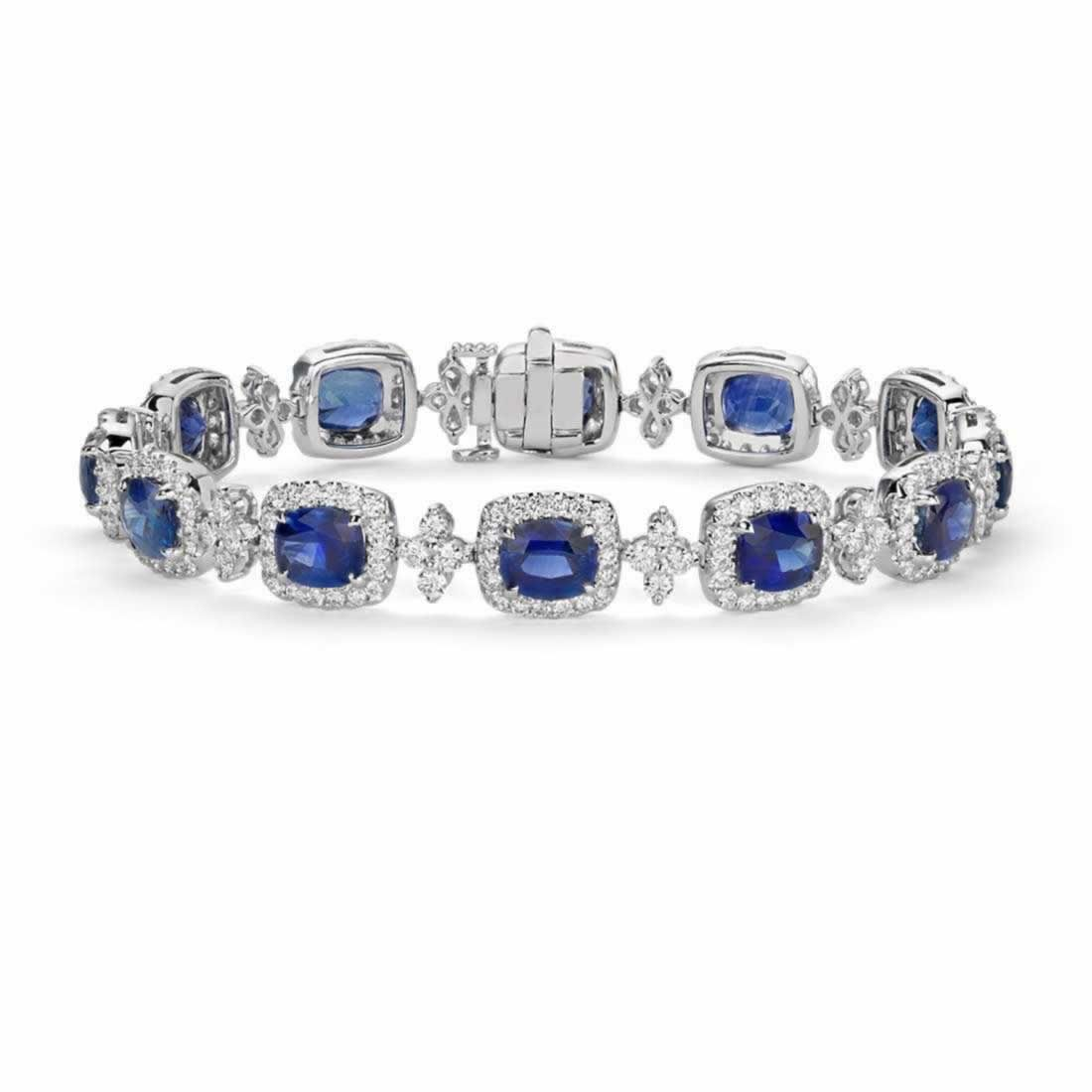 Cushion blue sapphire and halo diamond bracelet in k white gold